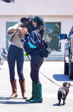 Kourtney Kardashian Adds a pair of green western boots to her all black outfit in Malibu