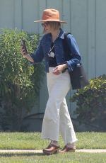 Kristen Bell Picks an odd place to try on a new necklace while visiting a friend in Los Angeles