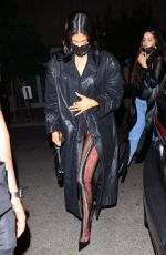Kylie Jenner As she hides her curvy figure under a black trench coat while at The Nice Guy in West Hollywood