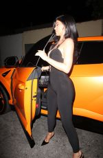 Kylie Jenner Hops out her Lambo in a sexy jumpsuit at Craig