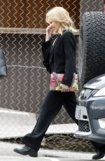 Kylie Minogue Is all smiles as she arrives at Risk Sound Recording Studios in Port Melbourne