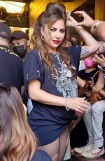 Lady Gaga Wears fishnet with short shorts and a graphic tee while hanging out at The Abbey Food & Bar in West Hollywood
