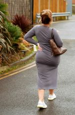 Lauren Goodger Shows off her growing baby bump in a grey dress as she heads out in Chigwell