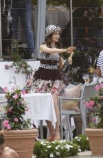 Lily Collins Gets into character while on set filming scenes for