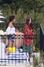 Lily Collins In a bikini filming scenes for