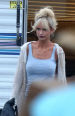 Lily James In character as Pamela Anderson on the set of