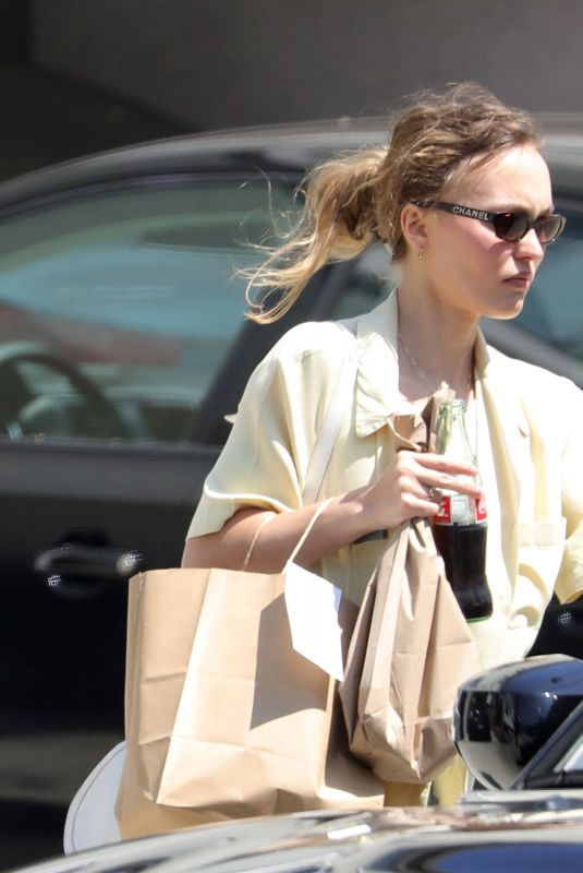 Lily-Rose Depp Has Her Hands Full as She Heads to a Graduation Party in Los Angeles