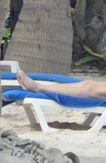 Lindsey Vonn Shows off her stunning figure as she relaxes in a bikini during a day at the beach in Tulum