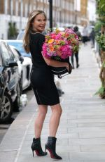 Lizzie Cundy At the R.H.Salon in Knightsbridge as she continues her 53rd birthday celebrations with new hair extensions and a two tier cake