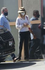 Lori Loughlin Looks chic as she stops by a luxury car dealership in Los Angeles