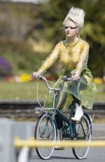 Maisie Williams Was spotted filming a scene where she rode a bike braless (Fake?) wearing a see-through plastic coat in Dover