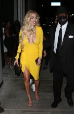 Mandana Bolourchi Wearing a low cut bright Yellow dress stuns as she arrived for dinner surrounded by security at Catch Restaurant in West Hollywood
