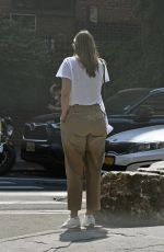 Maria Sharapova Wears a white tee, khaki pants and white sneakers while out and about in New York