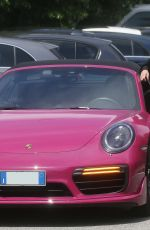 """Michelle Hunziker Goes to the """"Mediaset"""" television studios with her fuchsia porsche in Milan"""
