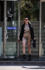 Michelle Hunziker Seen wearing a spring outfit without a face mask in Milan