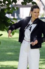 Michelle Hunziker Taking her pet greyhound named Odin to the park before going to visit a pet store to get him some goodies in Milan