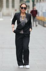 Myleene Klass In a black trouser suit and a printed top for Smooth radio appearance in London