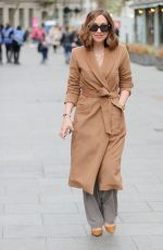 Myleene Klass In caramel colour belted coat and healed shoes for Smooth radio appearance in London