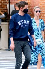 Nicky Hilton With no face mask and a blue spring dress is walking with her husband James Rothschild in Soho