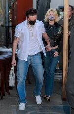 Nicola Peltz And Brooklyn Beckham take the back exit after dinner at Craig