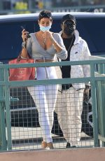 Nicole Murphy Shows off all her curves as she shops with a male friend in Beverly Hills