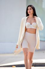 Nicole Williams English stops traffic during a street style fashion photoshoot in Beverly Hills
