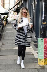 Olivia Attwood Avoiding a parking ticket as she grabs attention of a traffic warden while filming for series 2 of Olivia Meets Her Match at Brows By Sarah in Altrincham in Cheshire
