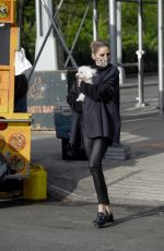 Olivia Palermo Heads out for a windswept selfie session with her adorable dog in New York