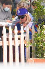 Paris Hilton and fiance Carter Reum go matching in blue while out in Malibu