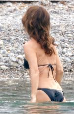 Philippine Leroy-Beaulieu Takes a quick dip in the cool ocean filming a scene for