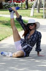 Phoebe Price Does what she does best at a park in Los Angeles
