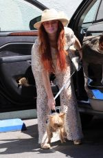 Phoebe Price Leaving with dog food and giving out a treat to her dog at the parking lot of Petco