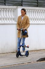 Pippa Middleton All smiles as she enjoys a scooter ride on the streets of London