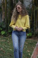 Rebecca Gayheart Playfully wrestles with her daughter while picking her up from a friend