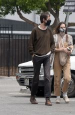 Scout Willis Carries her dog in a sling as she and boyfriend Jake Miller pick up an aluminum item from Home Depot in Los Angeles