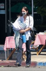 Scout Willis Gets air while jaywalking after grabbing her dry cleaning while running errands in Los Feliz