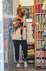 Sharna Burgess Wears a training bra while shopping at a pet store