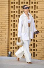 Shay Mitchell Flashes her toned abs in crop top and white denim combo in Los Angeles