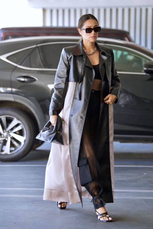 Shay Mitchell Looked stylish in a black crop top, cargo pants and a leather accented trench coat t in Beverly Hills