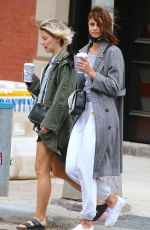 Taylor Hill Is walking with a friend in Tribeca, New York