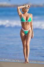 Tina Louise Displays her array of tattoos in a turquoise swimsuit as she hit the ocean in Venice