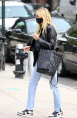Tish Cyrus Is walking with a friend in Soho