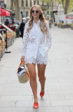 Vogue Williams Flashing legs in a white top and matching shorts at Heart radio studios in London