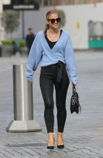 Vogue Williams Looks hot in skin tight trousers and blue cardigan at Heart radio in London