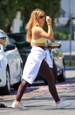 Addison Rae Wears a yellow top to her workout session in West Hollywood