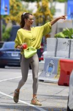 Alessandra Ambrosio Enjoys a cold drink as she makes her way to her car after having lunch with a friend in Beverly Hills