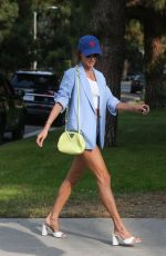 Alessandra Ambrosio Shows off her long legs in tiny denim shorts as she arrives to visit a friend in Santa Monica