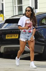 Alex Scott In denim shorts and a t-shirt while pictured enjoying a stroll in the sunshine in north London