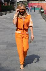 Amanda Holden Looks hot in a bright orange jumpsuit at Heart radio in London