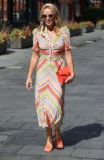 Amanda Holden Wears stylish head band and patterned dress at Heart radio studios in London